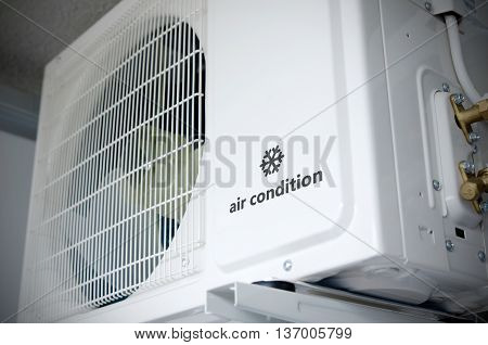 Air Conditioning Compressor Installation Outside Building With Sample Logo