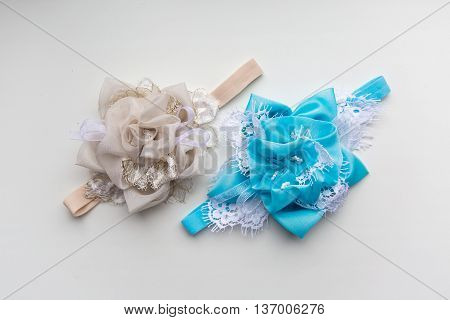 two baby headband, flower made of fabric and lace, beads on a white background
