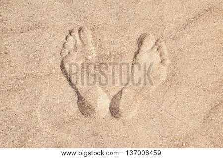 Footsteps in sandy on the beach. Top view