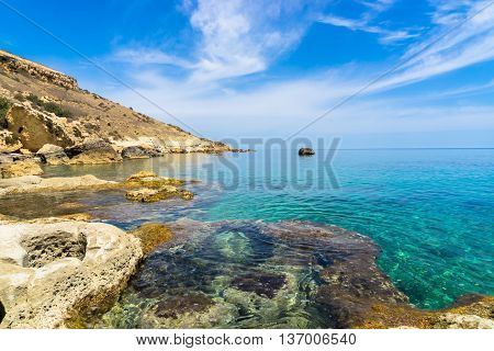 Rocky coastline of Gozo along the mediterranean sea