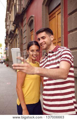 Happy Couple Taking A Selfie In A Old Street