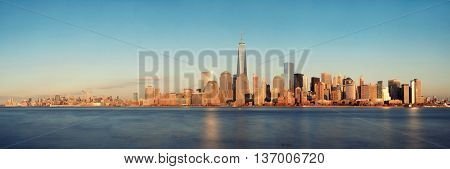 New York City skyline panorama with skyscrapers over Hudson River at sunset viewed from New Jersey