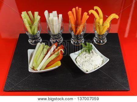 Healthy snacks - colofrul vegetable sticks and yogurt dip