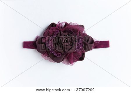 baby headband, flower made of fabric and lace, beads on a white background