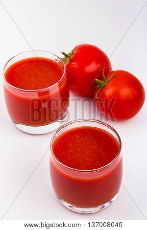 Glass full of freshly prepared tomat juice.