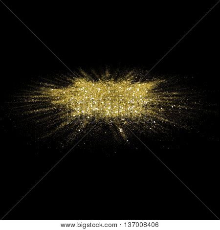 Gold glitter powder scattered on black background. Golden color dust splash on black horizontal surface. Flour specks with gold texture for fashion background, luxury. Magic mist glowing