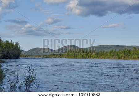 Water summer landscape surrounding the river Suntar in the Highlands of Oymyakon Yakutia Russia.