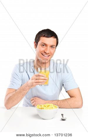 A Smiling Young Man At Breakfast