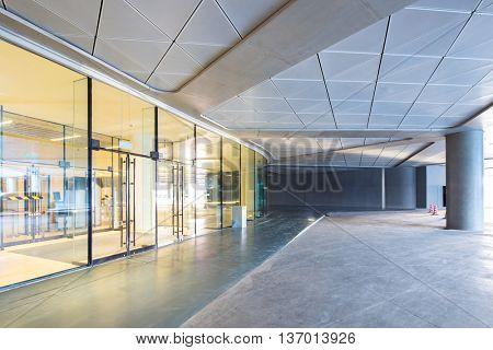 empty marble floor before round display window