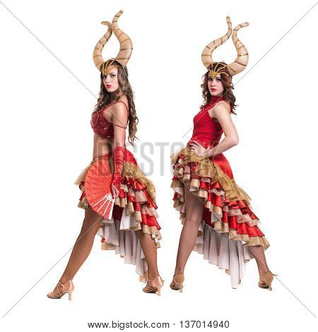 Two women dancers with horns. Isolated on white background in full length.