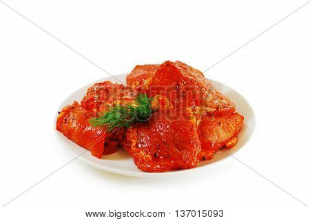 Raw Meat. Pork slices marinated with spices, pepper and sauce. Shashlik dish isolated on white