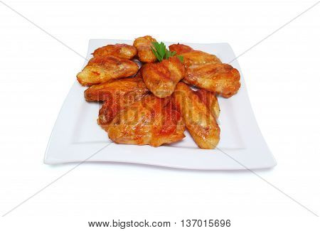 Buffalo chicken wings isolated on white background. Tasty Grilled meat.