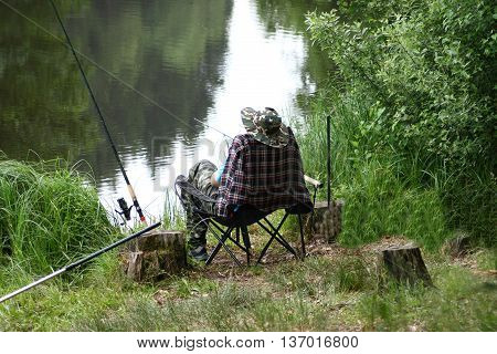 An angler on a idyllic small lake