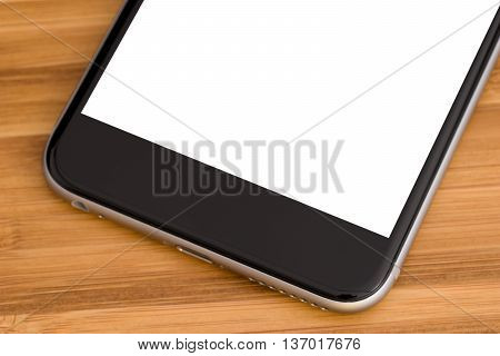 Smartphone on the table close-up isolated .