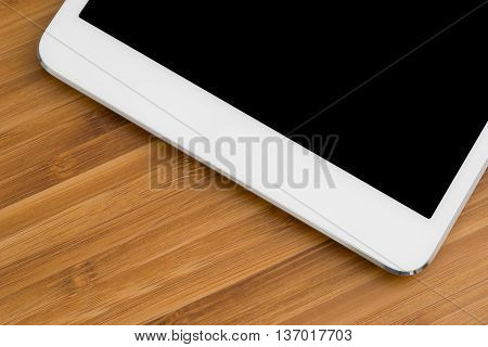 Tablet computer on the table close-up isolated