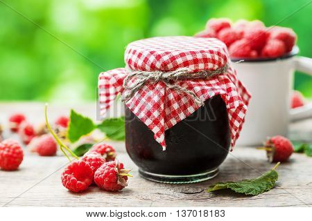Raspberries Jam And Fresh Berries On Table Outside