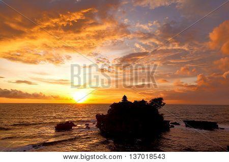 Sunset at Tanah Lot temple. Bali island Indonesia.