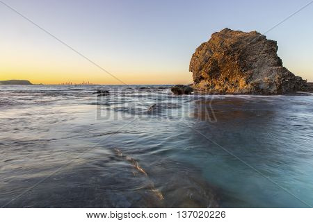 Currumbin Rock at high tide with sunset colours in the horizon