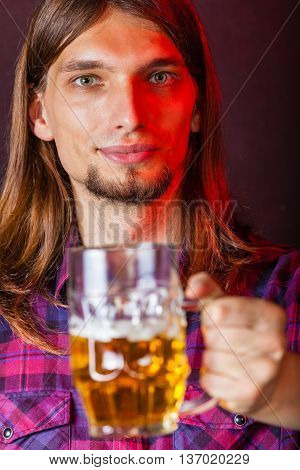 Alcohol liquor drinking party relax concept. Man holds glass of beer. Person holding stein filled with ale.