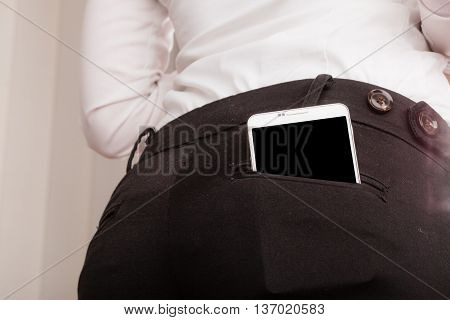 Mobile Phone In Rear Trousers Pocket.