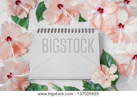 Notebook with pink Hibiscus flowers mock up background