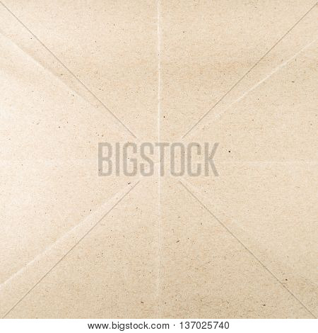 Brown recycled paper with creases for background.
