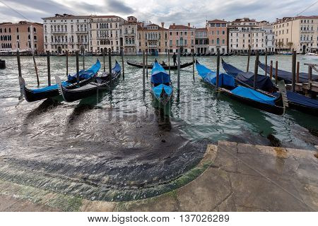 Gondolas Parked On The Grand Canal In Venice, Italy