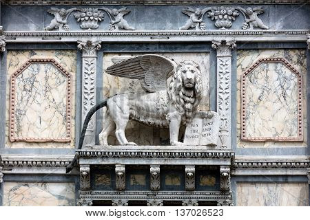 Lion of St. Mark on the facade of the Scuola Grande di San Marco in Venice Italy home to one of the six major sodalities or Scuole Grandi of Venice.