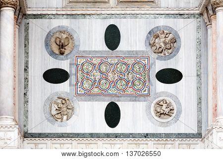 Medieval Venetian Gothic ornaments on the San Marco Basilica facade in Venice Italy
