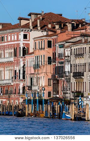 VENICE ITALY - APRIL 29 2016: Medieval palaces along the Venice Grand Canal