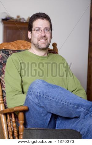 Man Sitting In Chair