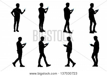 silhouette of man use smart phone and he is walking