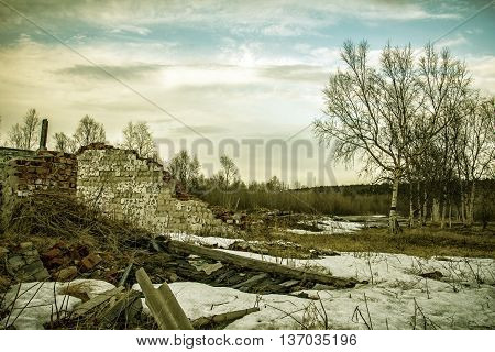 The remains of destroyed houses covered with snow