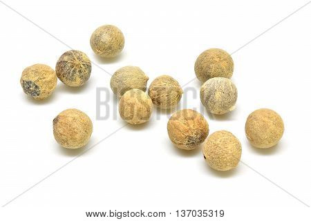 White peppers corns on a white background