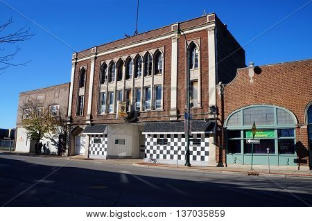 JOLIET, ILLINOIS / UNITED STATES - NOVEMBER 1, 2015: The historic building of the Ancient Order of Hibernians,  Irish Catholic fraternal organisation, now houses Joliet Transmission in downtown Joliet.