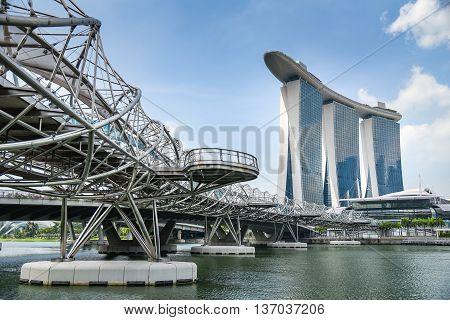SINGAPORE - MAY 6 2016 : Cityscape of Singapore Helix bridge and Marina Bay Sands hotel.