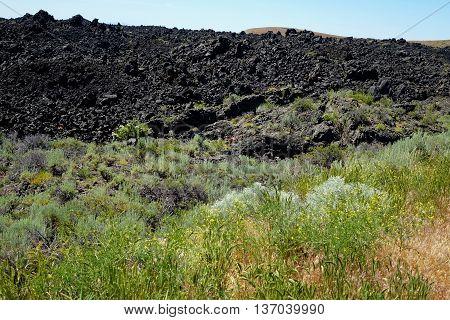 Craters of the Moon National Monument exists along the Great Rift of Idaho and includes several huge lava flow areas.