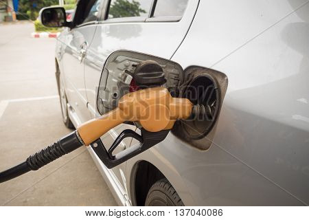 Car Refueling On A Gas Station.