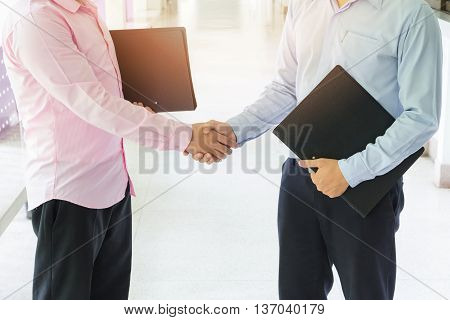 Business concept, Young business men shaking hands