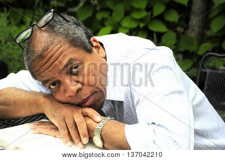 African american male senior expressions outside alone.