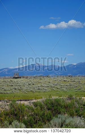 Mountains provide a beautiful background for corrals and sagebrush grazing land near Dillon, Montana.