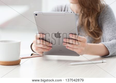 Alushta Russia - May 29 2016: Woman holding in the hand a new iPad Pro Space Gray. iPad Pro was created and developed by the Apple inc.