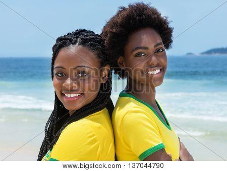 Two brazilian fans at Copacabana beach at Rio de Janeiro outdoor in the summer