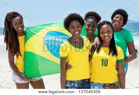 Group of brazilian fans with flag at Copacabana beach at Rio de Janeiro outdoor in the summer