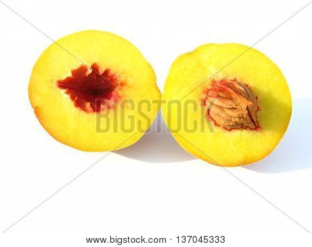 closeup of yellow peach (Prunus persica) isolated on white background