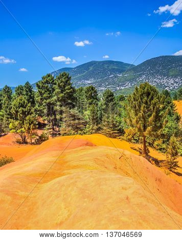 Languedoc - Roussillon, Provence, France. Red picturesque hills. The reserve - pit on production ochre