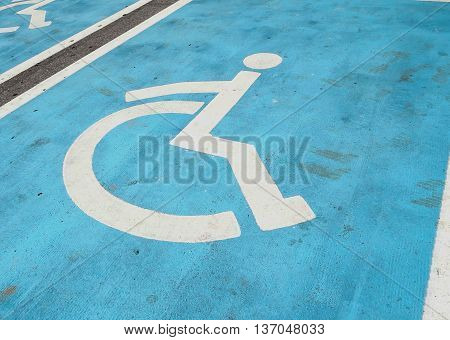 the parking space for handicapped people where they can park near the building.