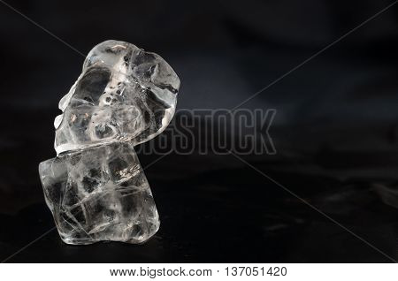 Ice cubes isolated over a black background