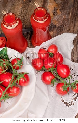 Tomato juice (tomato smoothie) - healthy beverage, refreshing drink in jar on rustic table