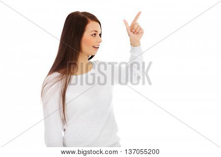 Young happy woman threatens someone the finger